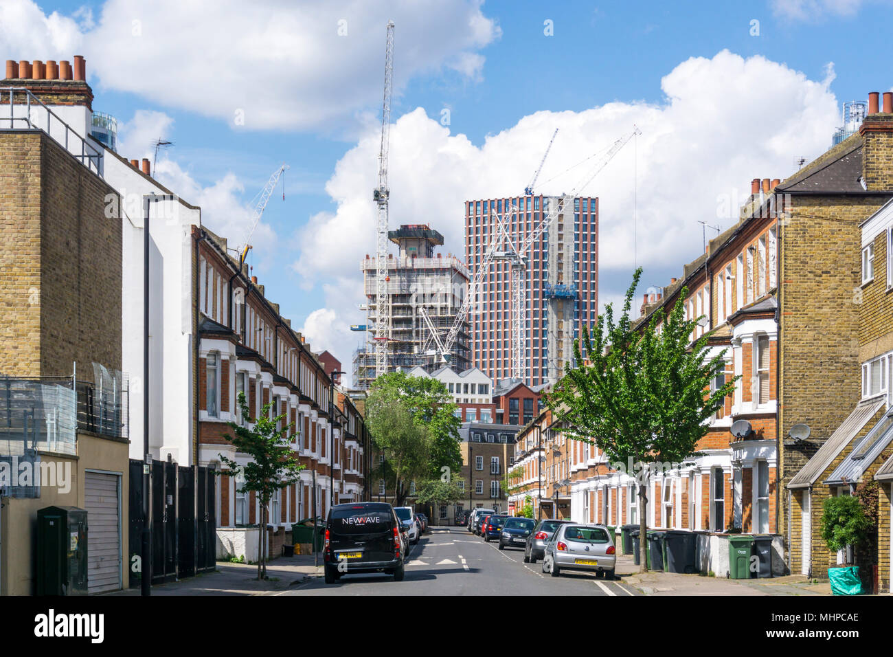 New developments at Nine Elms,Vauxhall seen rising over the terraced houses of Rita Road, Lambeth. - Stock Image