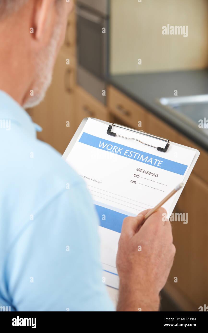 Builder Preparing Estimate For Home Improvement - Stock Image