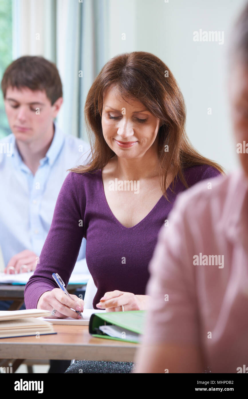 Mature Woman In Adult Education Class Stock Photo