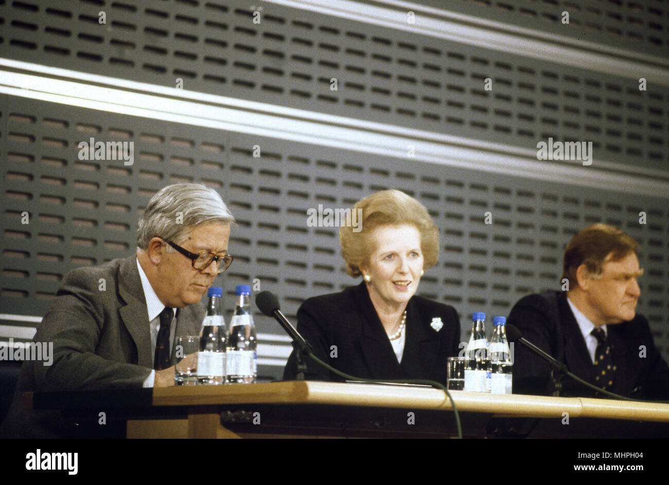 Margaret Thatcher (British Prime Minister), Geoffrey Howe (Foreign Secretary) and Bernard Ingham (Press Secretary) at a press conference in London, soon after an important visit by Mikhail Gorbachev, Russian President.     Date: circa 1984 - Stock Image