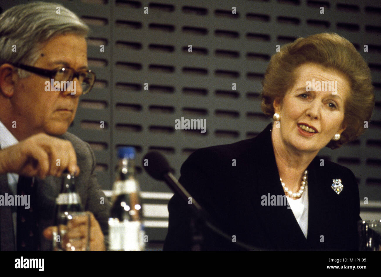 Margaret Thatcher (British Prime Minister) and Geoffrey Howe (Foreign Secretary) at a press conference in London, soon after an important visit by Mikhail Gorbachev, Russian President.      Date: circa 1984 - Stock Image