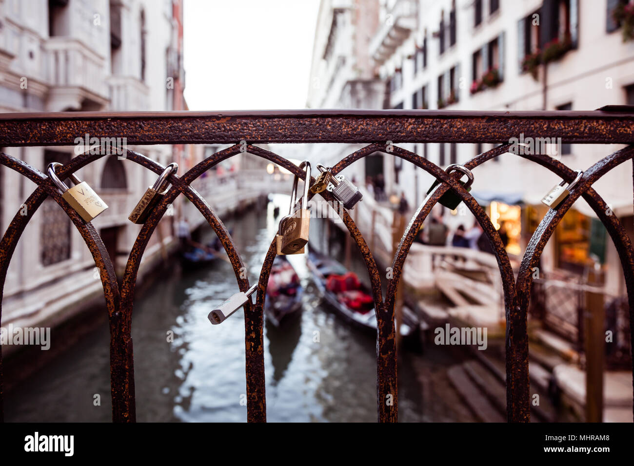Lovers padlocks on a bridge in Venice, Italy - Stock Image