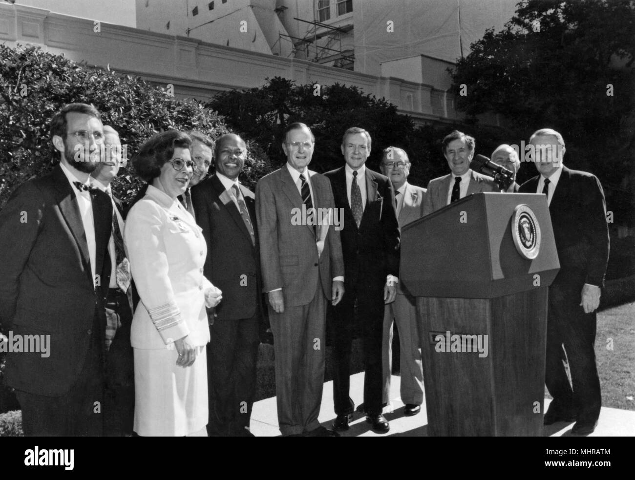 Centers for Disease Control (CDC) officials in visit to the White House, CDC Director at that time, William L. Roper, former Director, James O, 1991. Mason, Surgeon General, Antonia C. Novello, Senator Arlen Specter, Health and Human Services Secretary, Louis Sullivan, President George H.W. Bush, Senator Orrin Hatch, Congressman Jamie L. Whitten, Senator John H. Chaffee, Congressman Norman F. Lent, and Senator Dale L. Bumpers. () - Stock Image