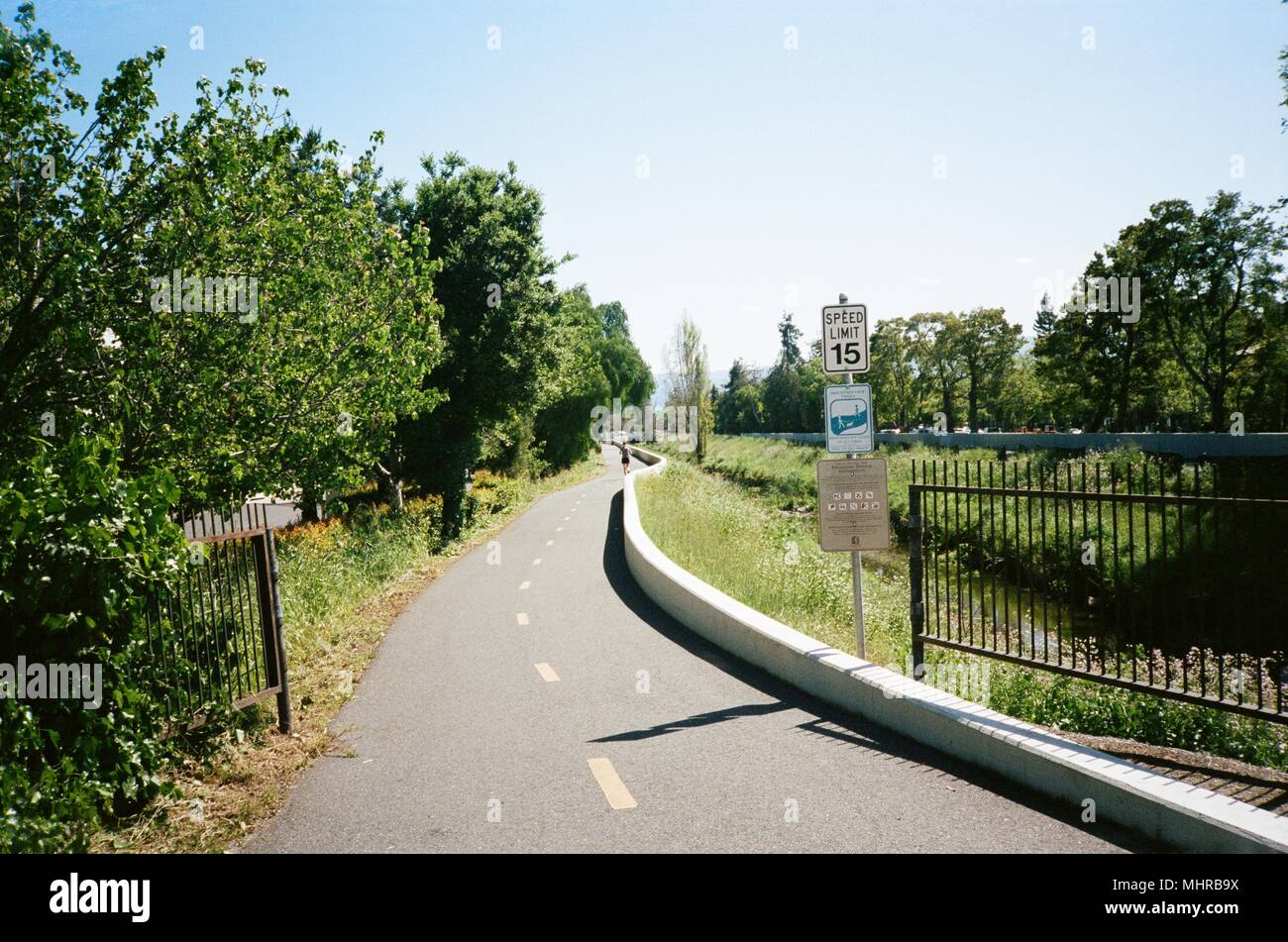 View down Permanente Creek Trail at the Googleplex, the Silicon Valley headquarters of search engine and technology company Google Inc in Mountain View, California, a popular running trail for employees of Google Inc, April 14, 2018. () - Stock Image