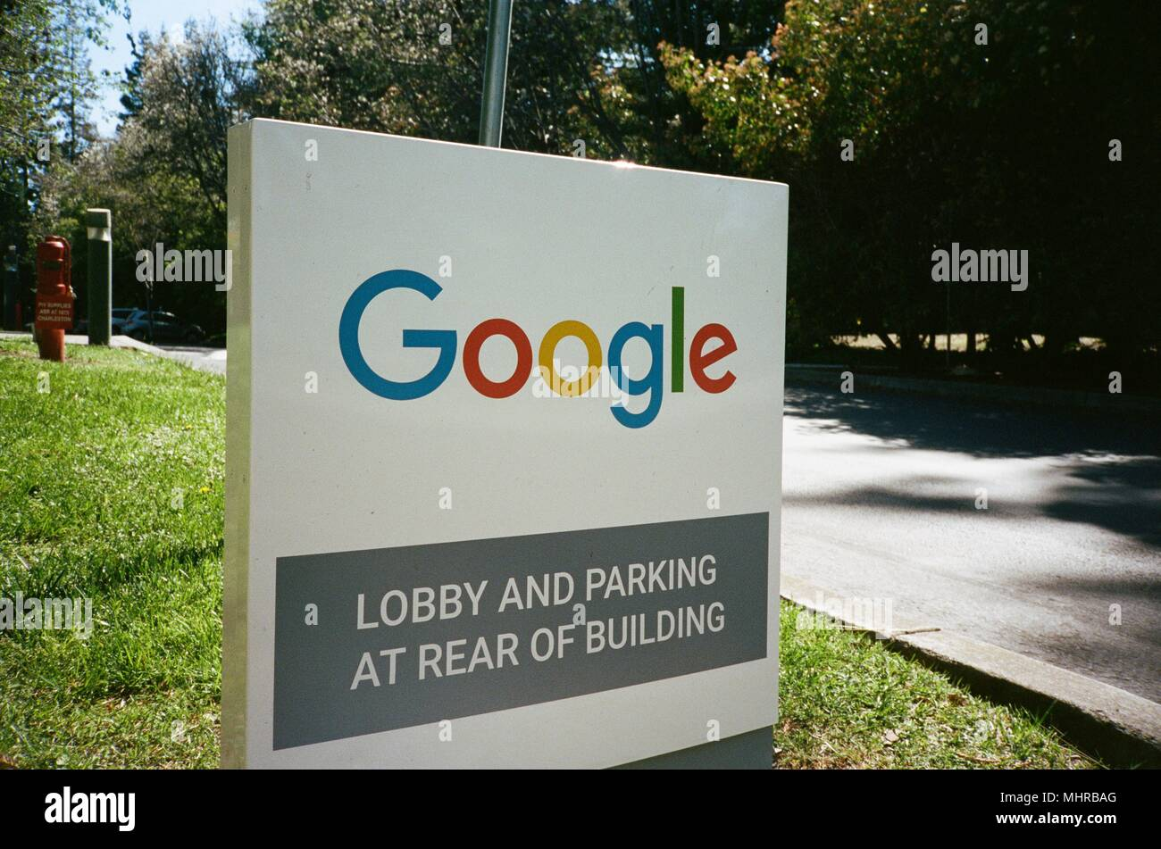 Sign with logo at the Googleplex, the Silicon Valley headquarters of search engine and technology company Google Inc in Mountain View, California, April 14, 2018. () - Stock Image