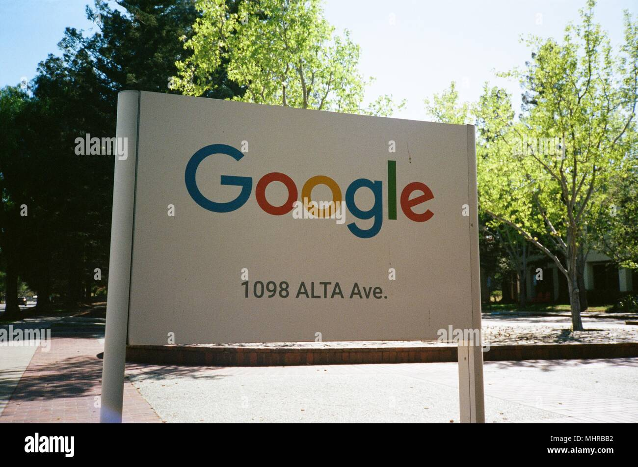 Low-angle view of sign with logo at the Googleplex, the Silicon Valley headquarters of search engine and technology company Google Inc in Mountain View, California, April 14, 2018. () - Stock Image