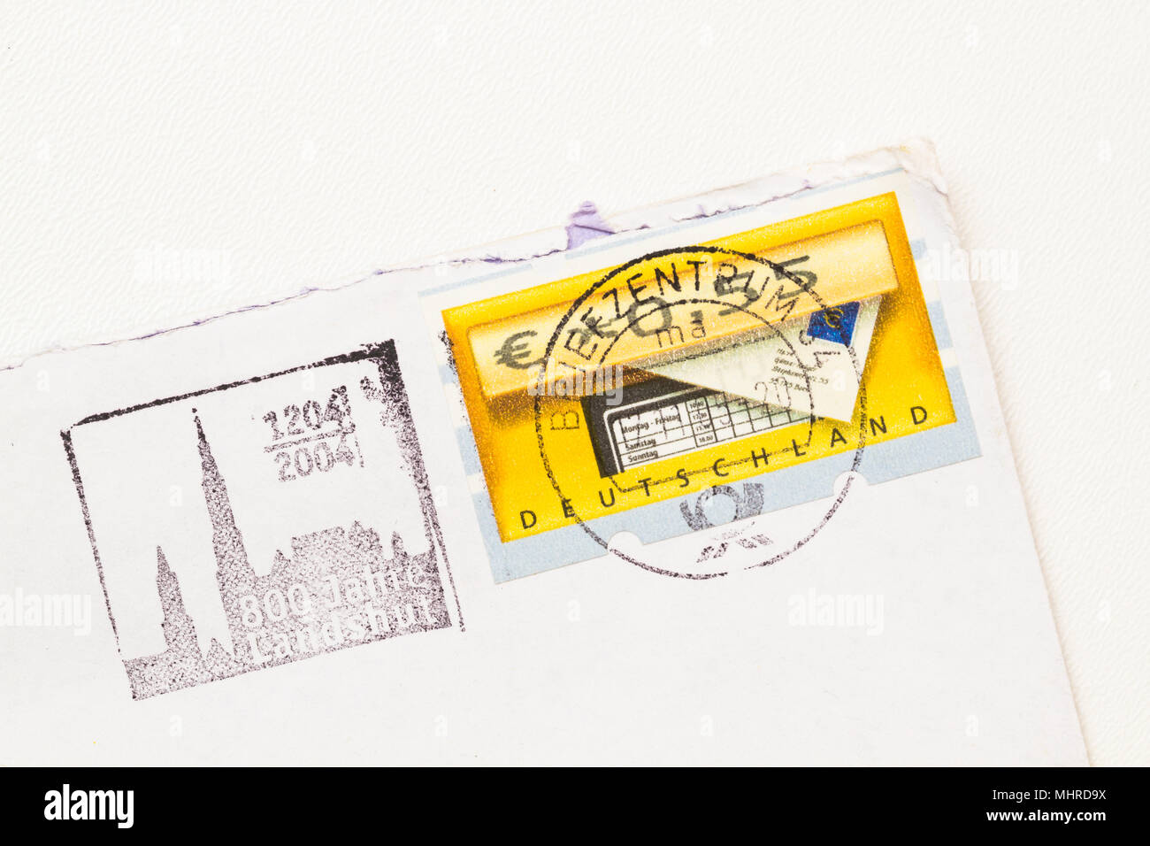Envelope dated from 2004 with Landshut, Germany Postage stamp on white paper, white background. - Stock Image