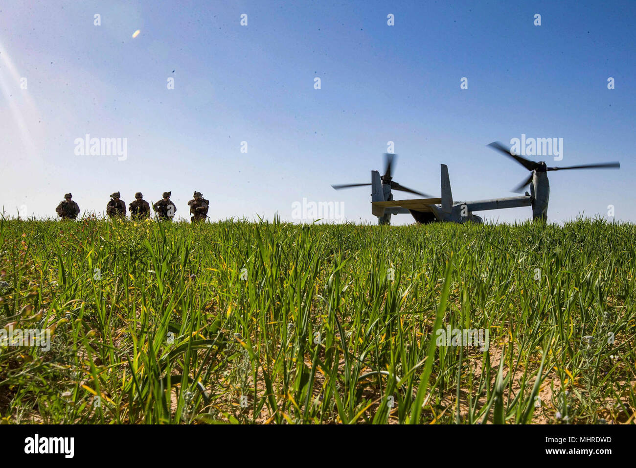 HAIFA, Israel (March 14, 2018) U.S. Marines assigned to the Tactical Recovery of Aircraft Personnel (TRAP) team, 26th Marine Expeditionary Unit (MEU), arrive in a landing zone of an MV-22B Osprey aircraft to conduct a simulated search mission, in Haifa, Israel, March 14, 2018. Juniper Cobra is a computer assisted exercise conducted through computer simulations focused on improving combined missile defense capabilities and overall interoperability between the U.S. European Command and Israel Defense Force. (U.S. Marine Corps Stock Photo