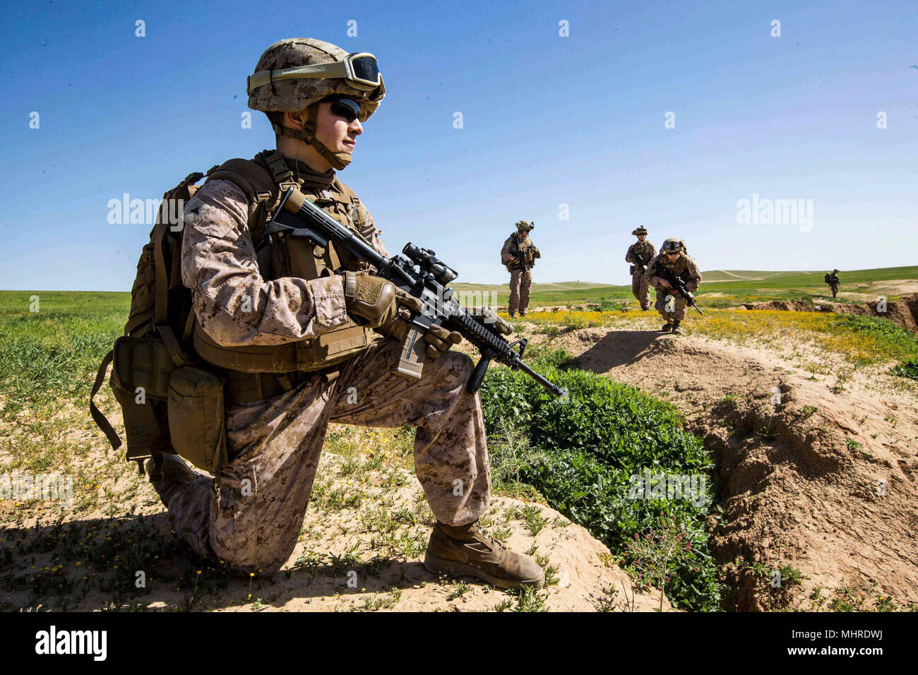 HAIFA, Israel (March 14, 2018) U.S. Marine Lance Cpl. Michael A. Ospina, a mortarman assigned to the Tactical Recovery of Aircraft Personnel (TRAP) team, 26th Marine Expeditionary Unit (MEU), surveys the surrounding area during a simulated search mission, in Haifa, Israel, March 14, 2018. Juniper Cobra is a computer assisted exercise conducted through computer simulations focused on improving combined missile defense capabilities and overall interoperability between the U.S. European Command and Israel Defense Force. (U.S. Marine Corps Stock Photo