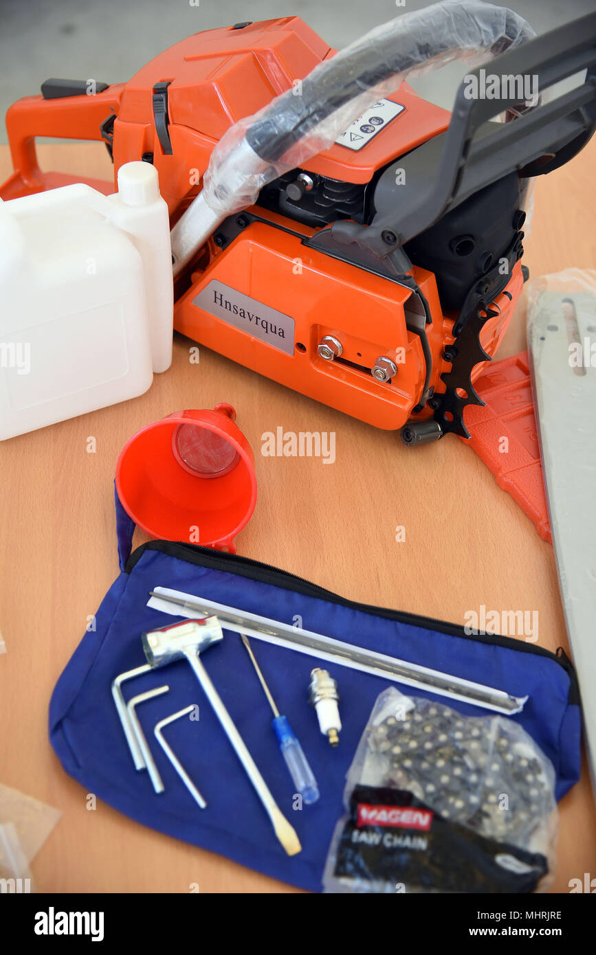 18 April 2018, Germany, Cologne: Counterfeit chainsaw of the brand 'Husqvarna' is presented at a press conference of Cologne's main customs office. Photo: Henning Kaiser/dpa - Stock Image