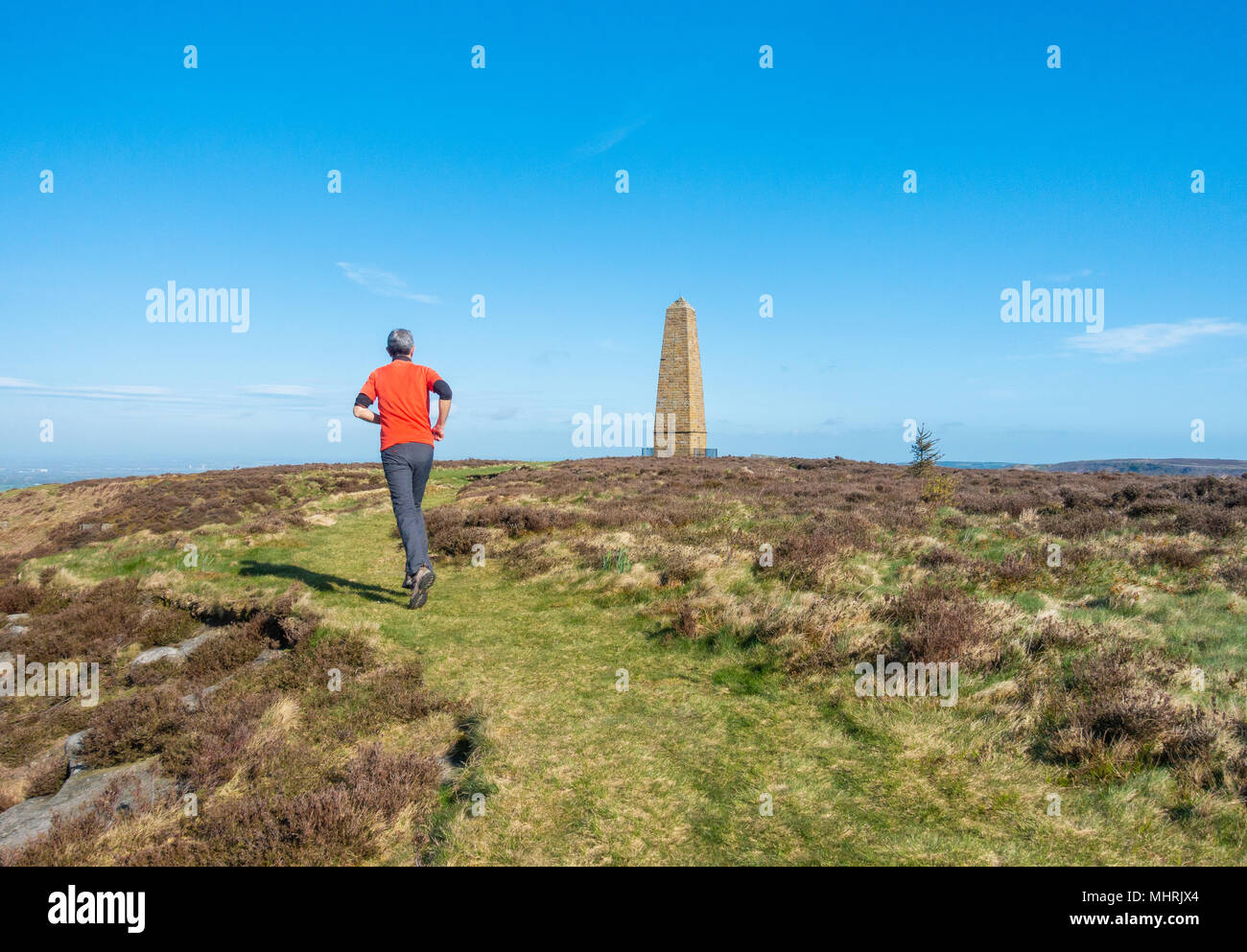 Easby Moor, North York Moors National Park North Yorkshire, England, UK. 3rd May, 2018. Weather: Glorious sunshine in North Yorkshire. A walker near Captain Cook`s monument on Easby Moor, which overlooks the boyhood village of James Cook, Great Ayton. 2018 marks the 250th anniversary of Captain Cook`s first Pacific voyage, with events planned nationwide to commemorate the event. Credit: ALAN DAWSON/Alamy Live News - Stock Image