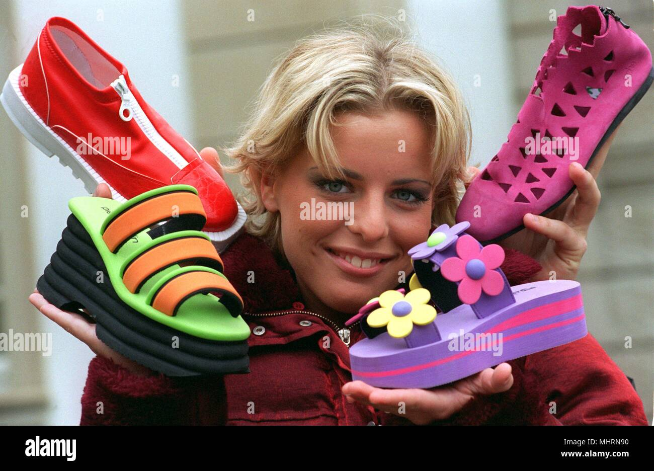 Sporty summer shoes with profiled rubber soles and zip fasteners as well as funny slippers in cheesy colors with layered lightweight platform soles will be shown by Lena on January 21, 1998 in Offenbach at the presentation of the new shoe fashion. Women are moving on a lighter footing in the spring/summer of 1998 if they want to go with fashion. | usage worldwide - Stock Image