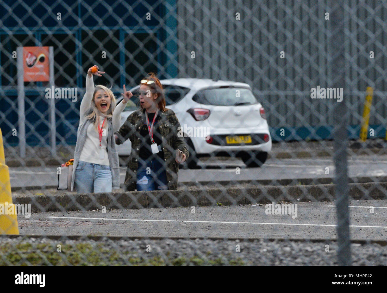 Swansea, South Wales, UK. May 3rd 2018 The Virgin Media call centre in Swansea, South Wales, where news broke today that almost 800 jobs are to go as the company plans to call the Swansea base. Two members of staff look more than happy as they leave. Credit: Robert Melen/Alamy Live News. Stock Photo