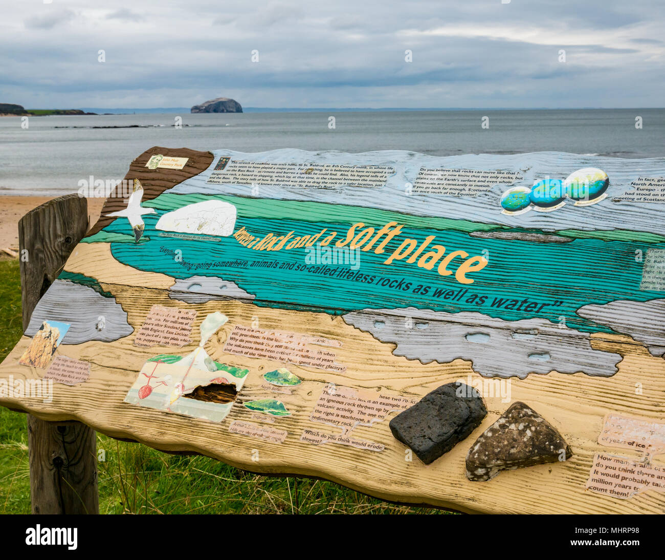 Ravensheugh Sands, East Lothian, Scotland, United Kingdom, May 2nd 2018. No-one on the beach with an information board in the dunes about the local geology, looking across the Firth of Forth towards the Bass Rock, home to the world's largest Northern gannet colony - Stock Image
