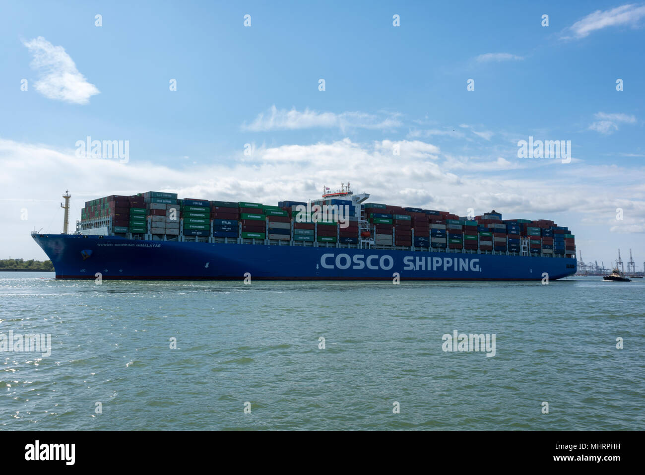 Southampton, UK. 3rd May, 2018. The Cosco Shipping Himalayas huge container ship sailing from the port of Southampton fully loaded with containers full of british goods being exported to worldwide businesses. International exports befor Brexit to Europe and the rest of the world from british businesses and manufacturing organisations. Credit: Steve Hawkins Photography/Alamy Live News - Stock Image