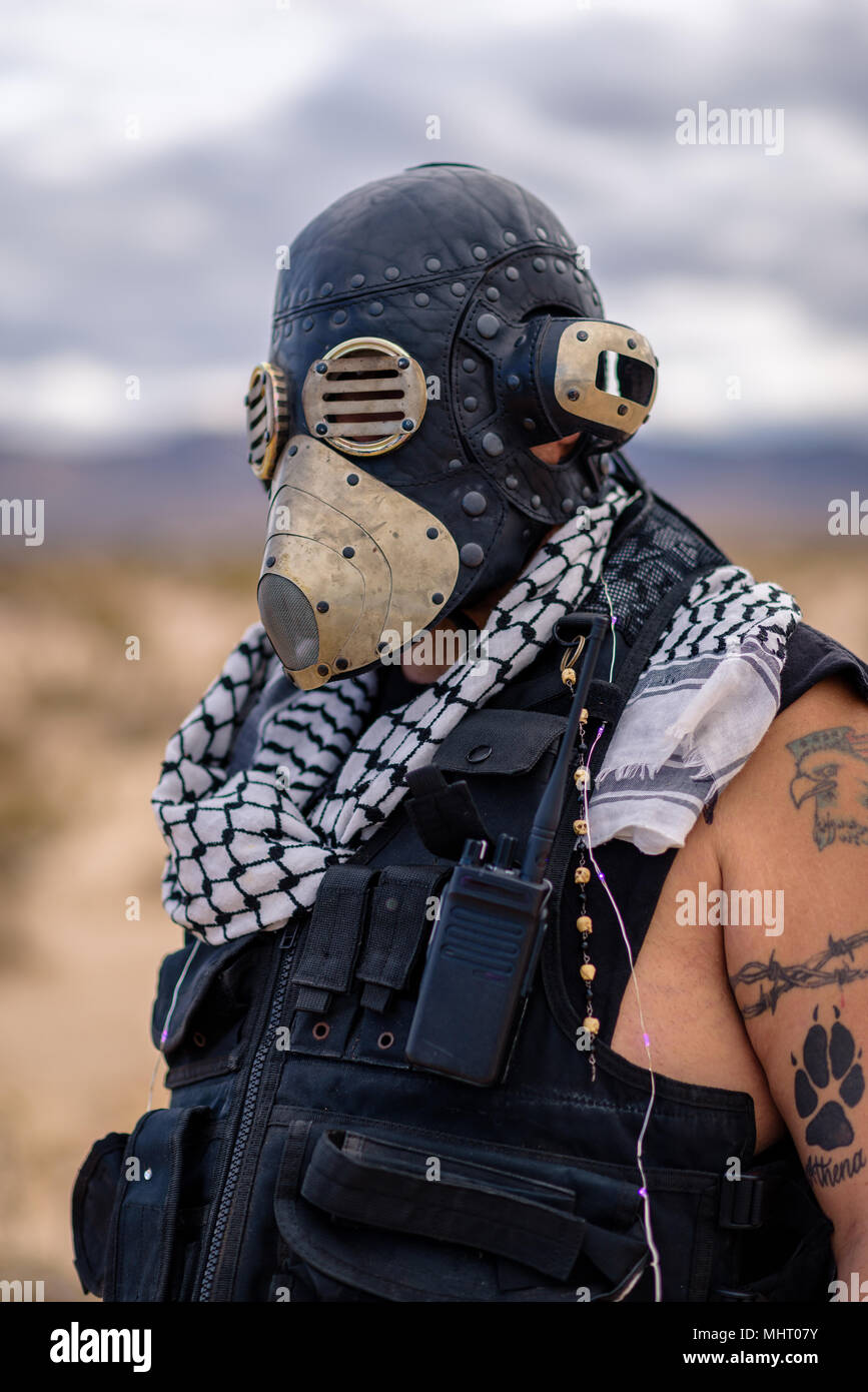 In a post-apocalyptic desert wasteland, a Queen of the Apocalypse leads her militia against the enemy. Armed to the teeth, who will win? - Stock Image