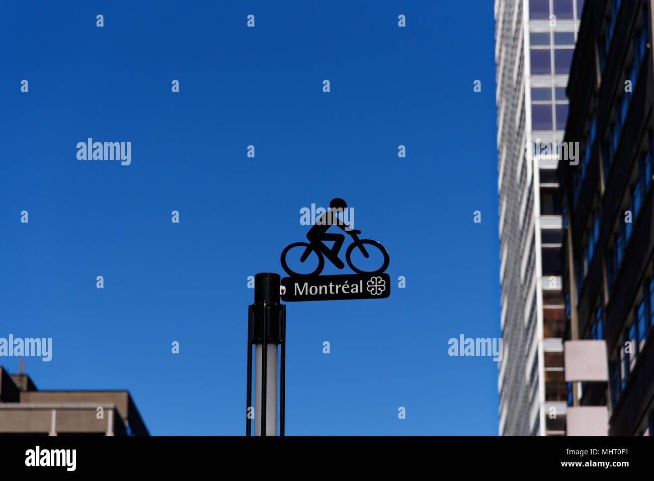 Sign for the Claire Morissette cycle path on Maisonneuve street in downtown Montreal, Quebec, Canada - Stock Image