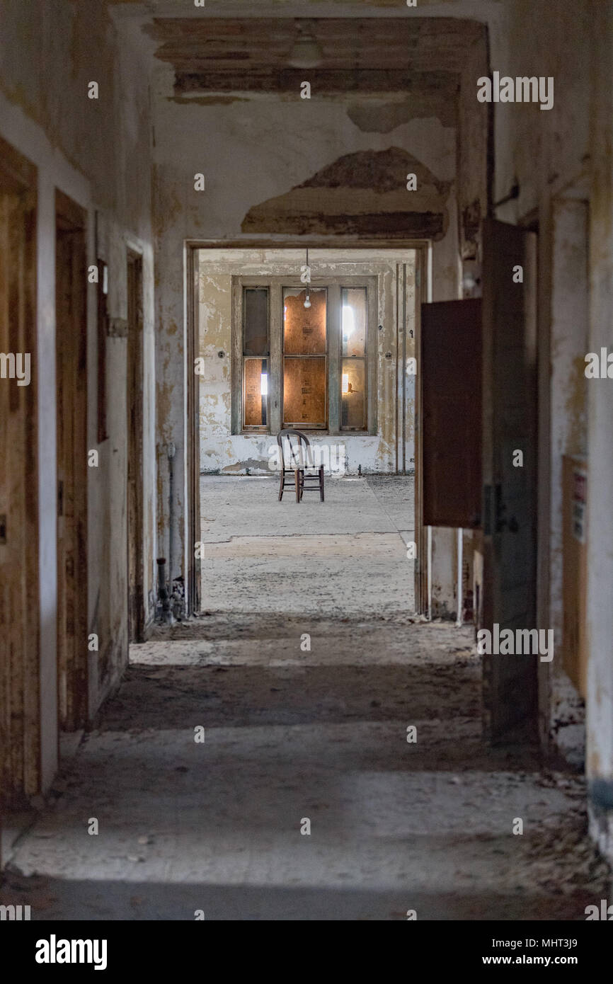 abandoned psychiatric hospital interior rooms view - Stock Image