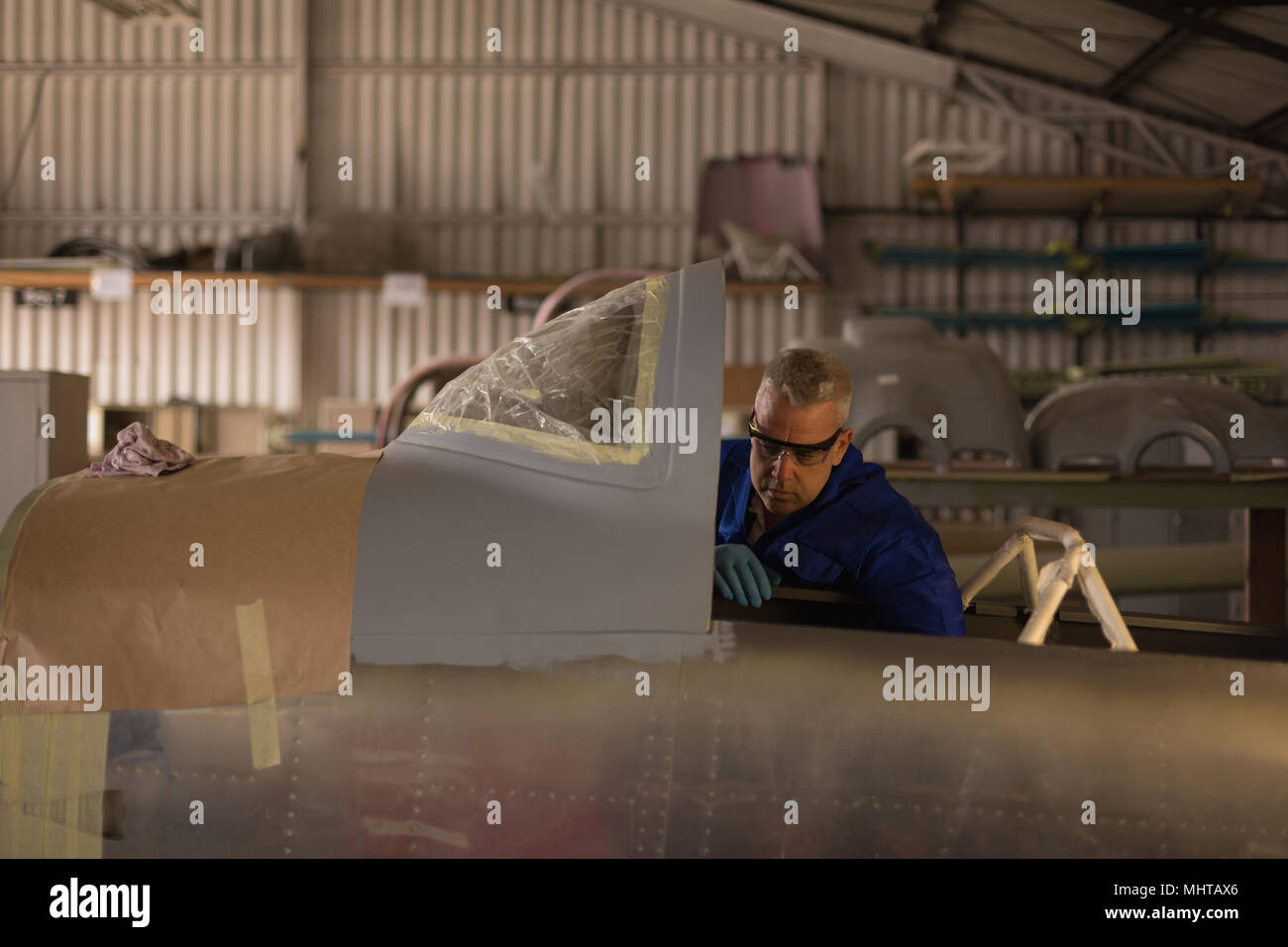 Engineer checking parts of plane - Stock Image
