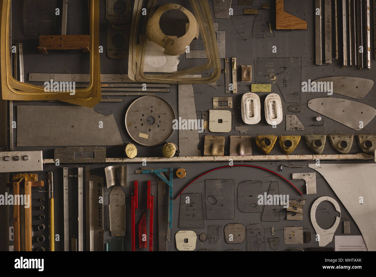 Various tools and equipments arranged on pegboard - Stock Image