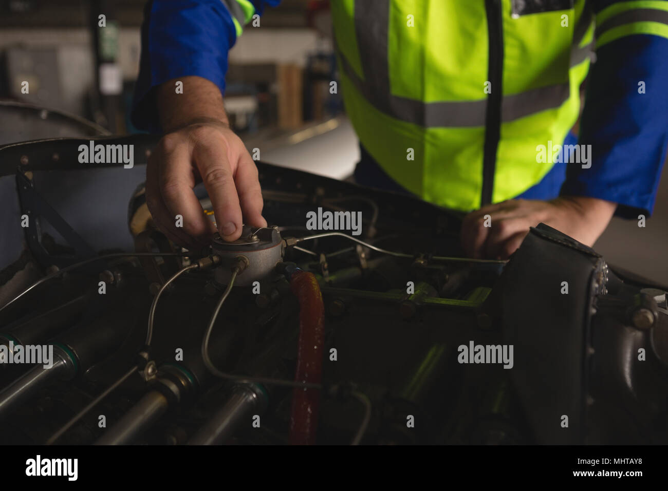 Engineer repairing aircraft engine - Stock Image