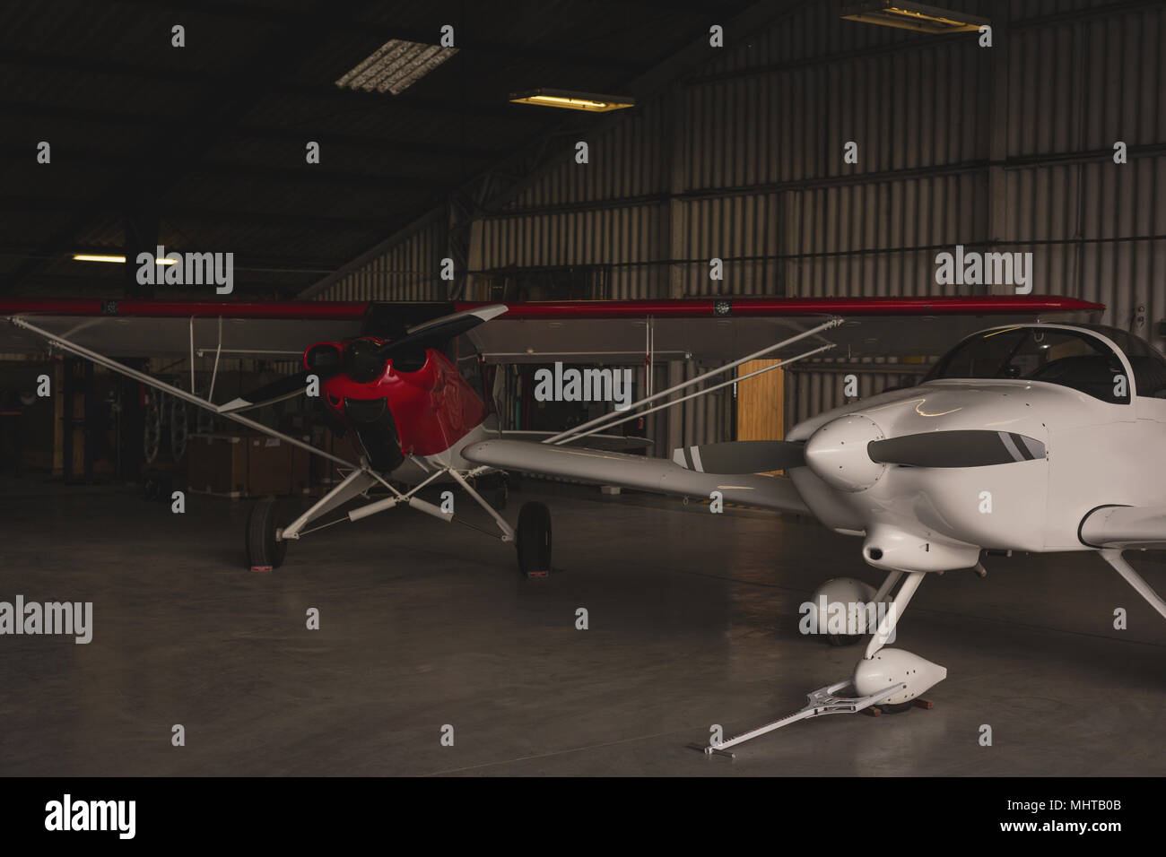 Two aircrafts parked in aerospace hangar - Stock Image