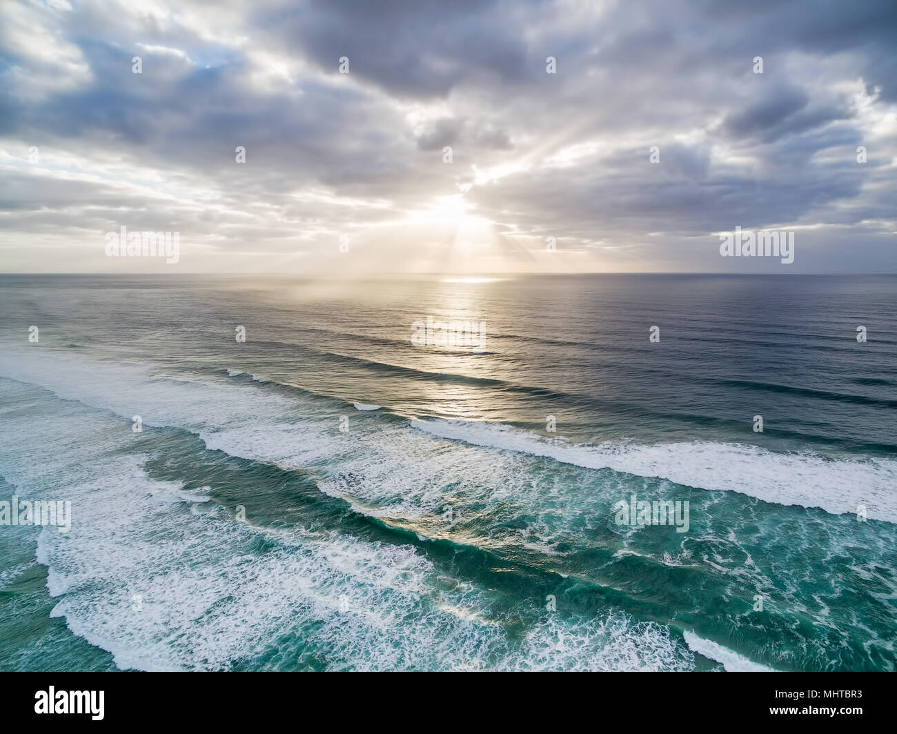 Sunset over ocean - minimalist landscape - Stock Image