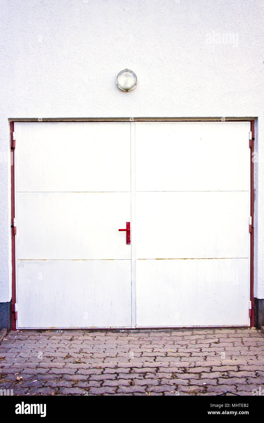 White Metal Double Door With Red Handle Stock Photo 183090966 Alamy