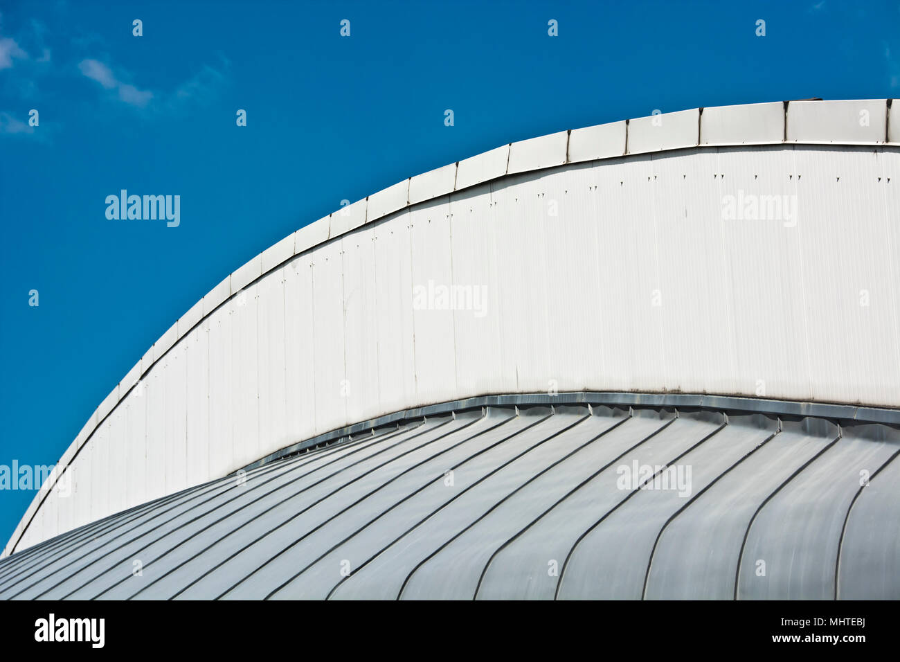 white building structure against a blue sky - Stock Image