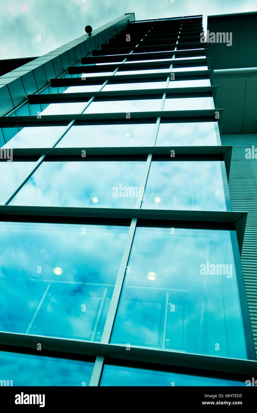 low angle view of a modern building of glass and steel - Stock Image