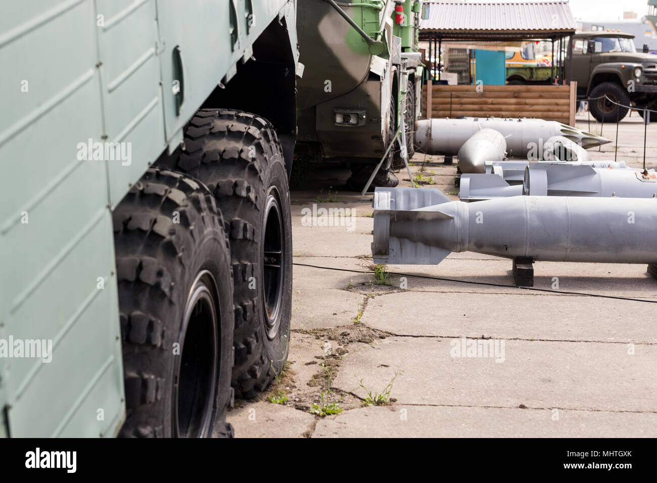 Military base with weapons and heavy machinery.  Army naval post with air boms outdoors. Cold war and militarization concept - Stock Image