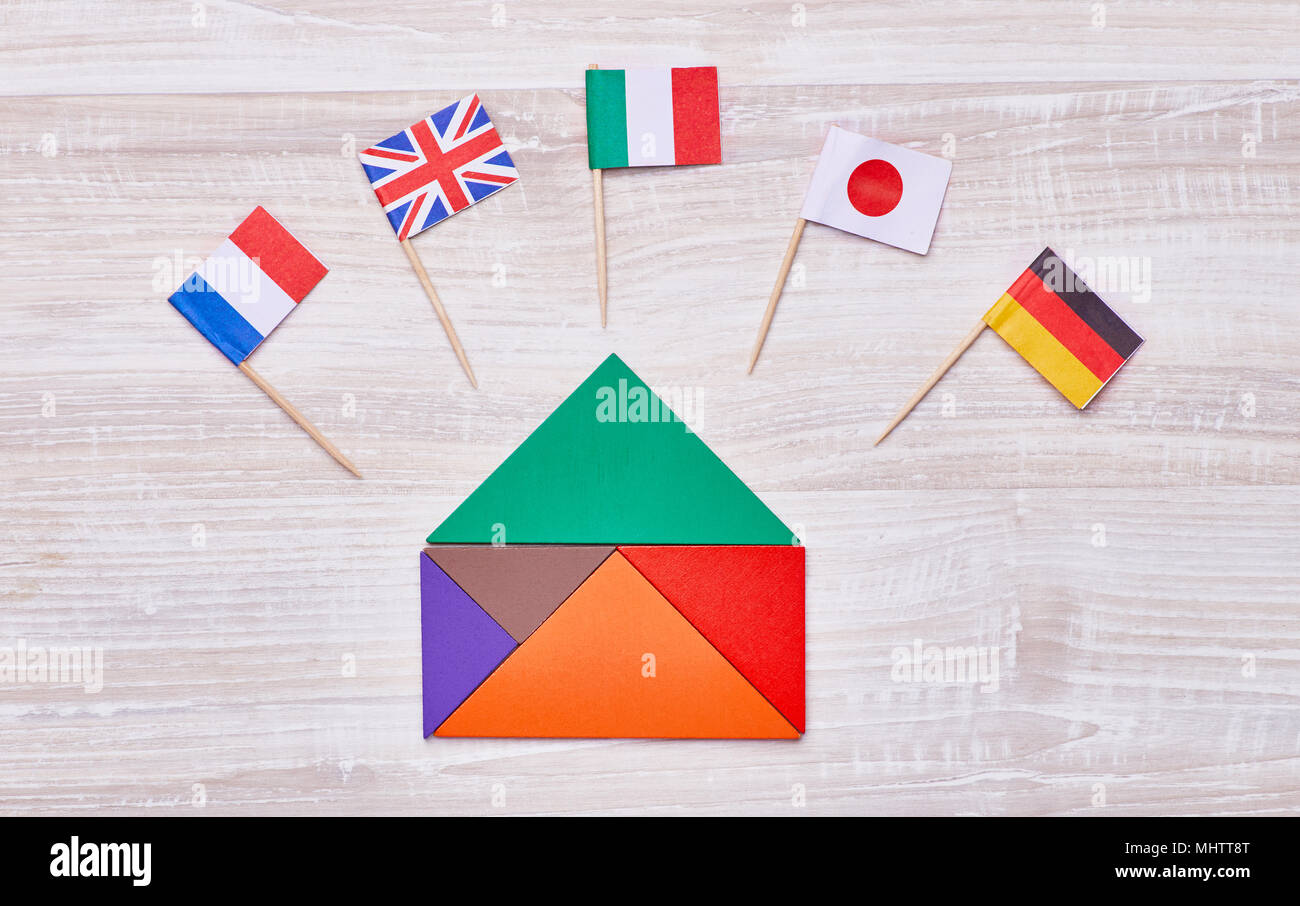 A colored house, assembled from geometric figures, with flags of different countries. Concept for language courses, translators, etc. - Stock Image