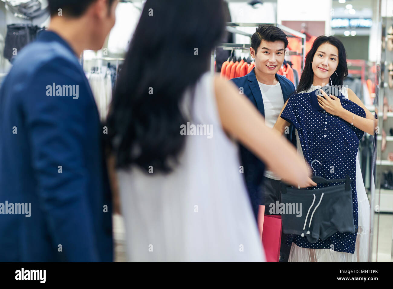 Young couples choose clothes clothing store - Stock Image