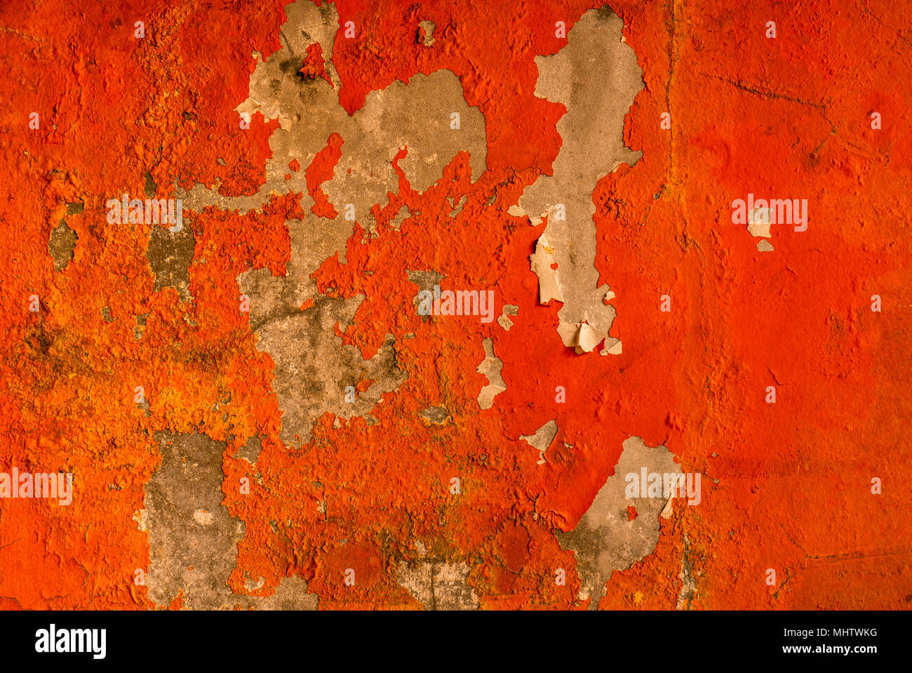Orange Color Painted On Concrete Wall Are Peeling. Old And Dirty Wall  Texture Background With
