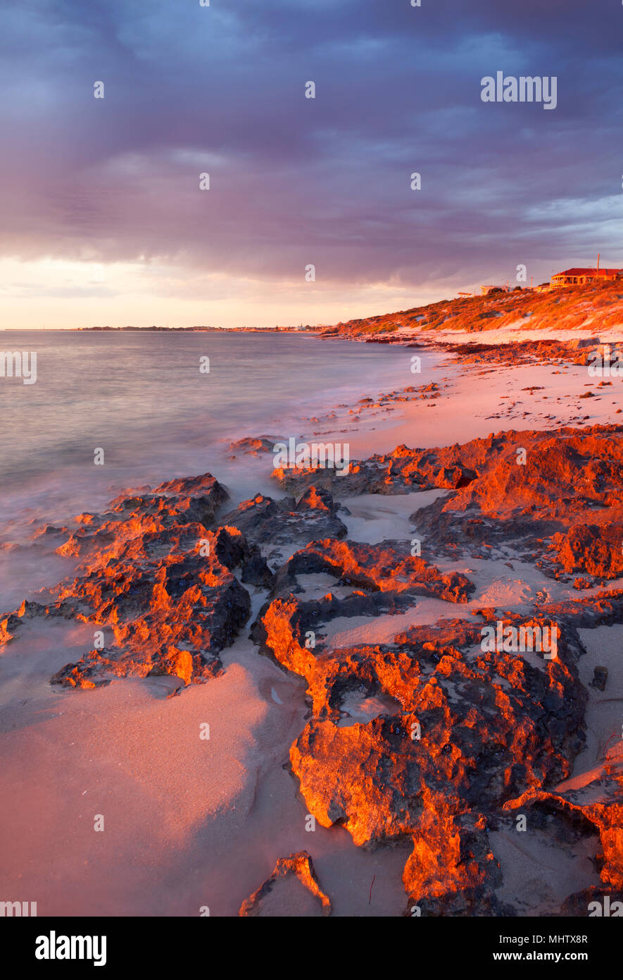 Limestone rocks at Watermans Beach at sunset.  Marmion Marine Park. Perth, Western Australia - Stock Image