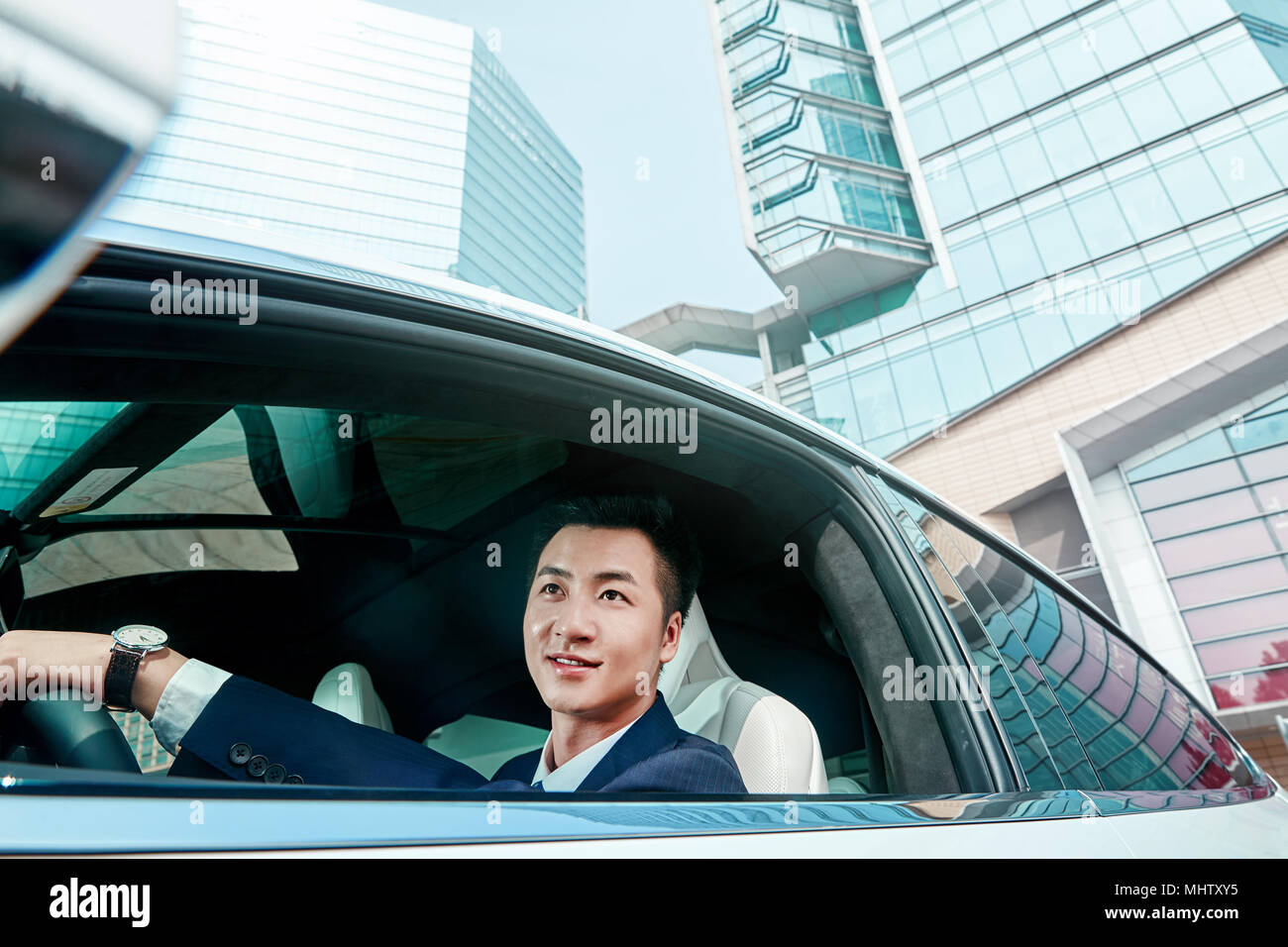 The business man driving a car - Stock Image