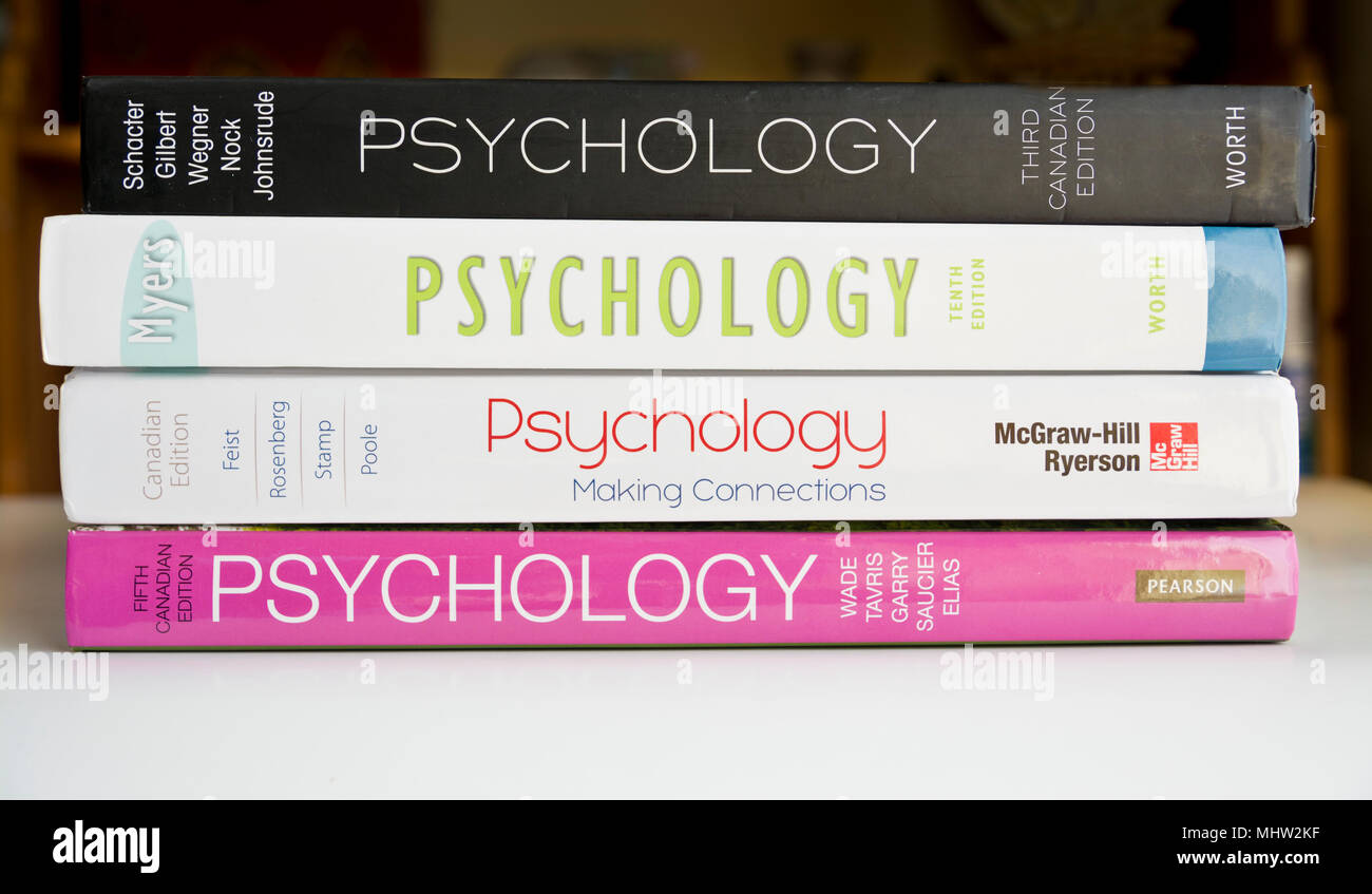 Pile of Introductory Psychology textbooks.  Psychology textbooks for college university. - Stock Image