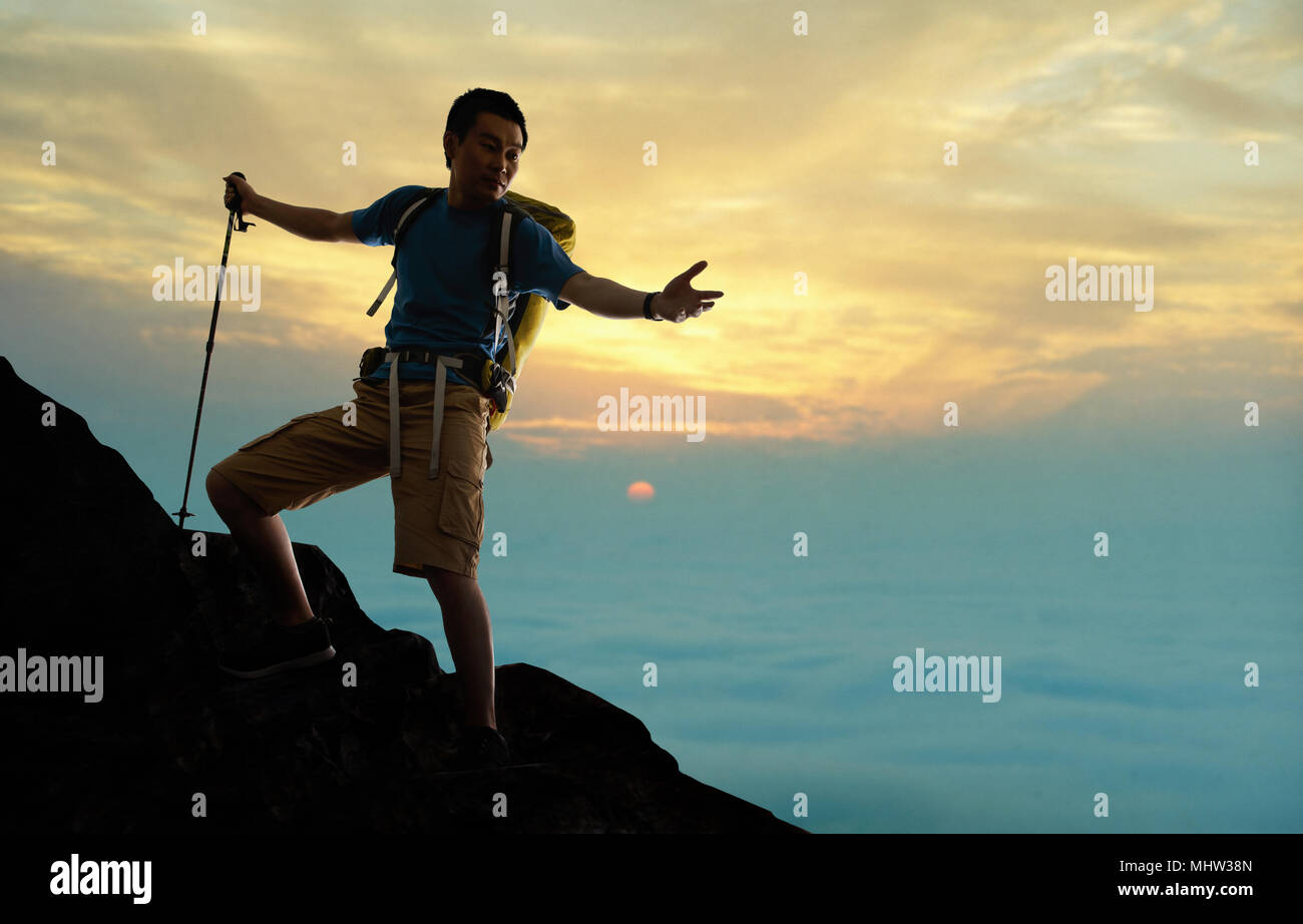 The middle-aged man climbing - Stock Image
