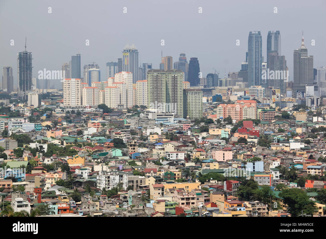 MANILA - April 2 2011: view over Ortigas from Makati towards Antipolo. Manila is the overcrowded capital of the Philippines and is located on the main - Stock Image