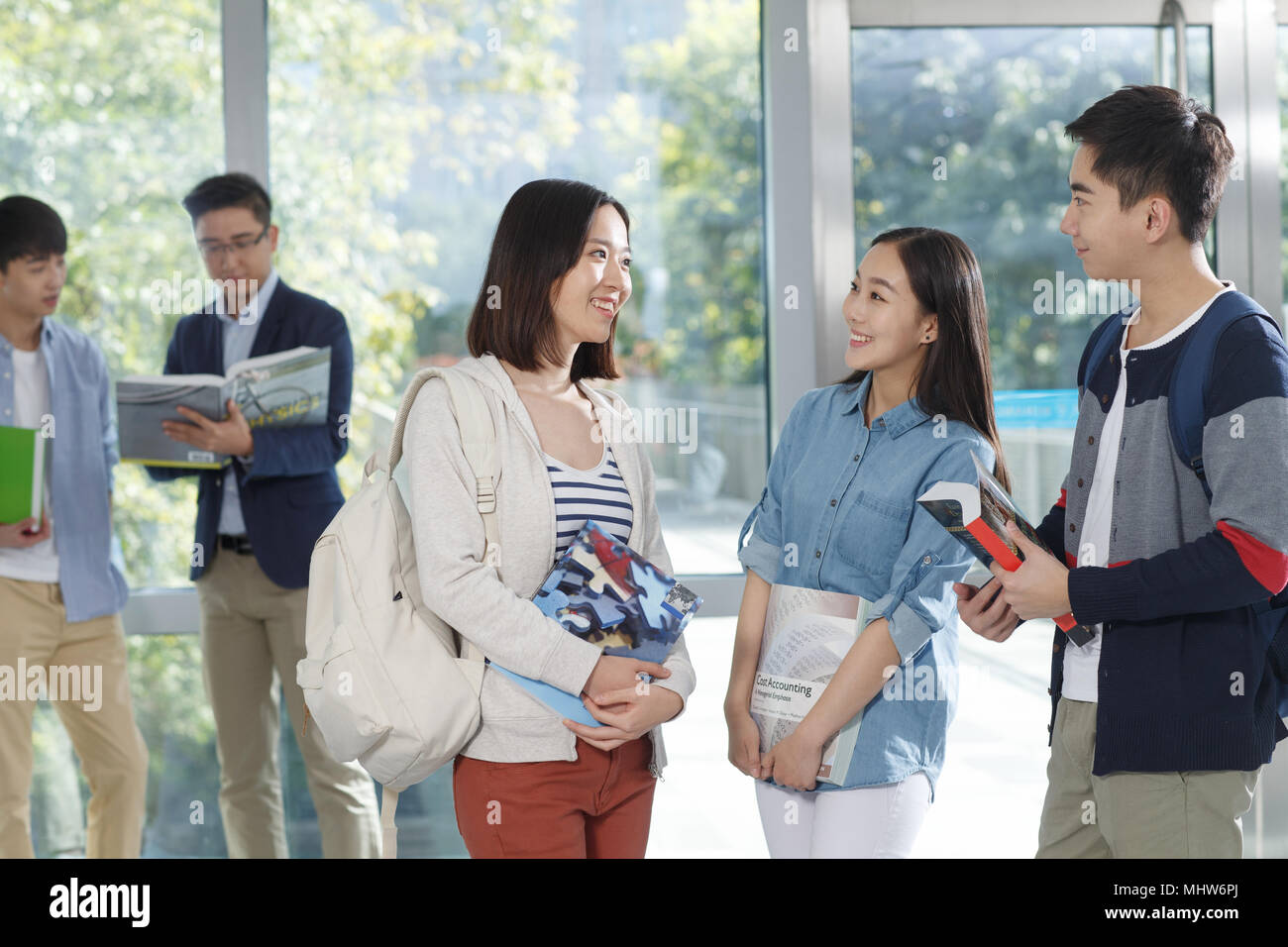 College students on campus in a conversation - Stock Image