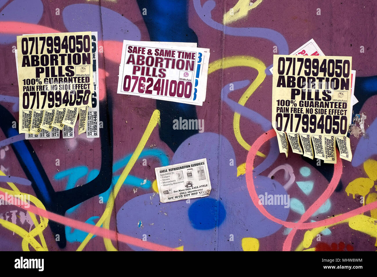 Abortion pills advertised on a wall in the Central Business District of Johannesburg, South Africa. - Stock Image