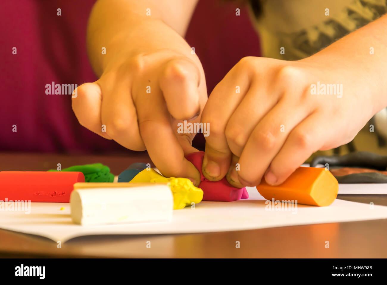 Child modeling plasticine.   Developing imagination and creativity. - Stock Image