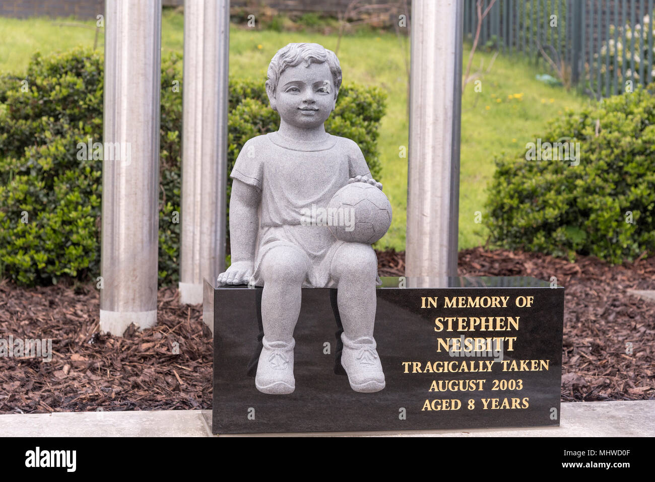 Football-mad Stephen Nesbitt tragically died after stepping on a live rail near Bootle Oriel Road station back in 2003. THe boy with the ball statue. - Stock Image