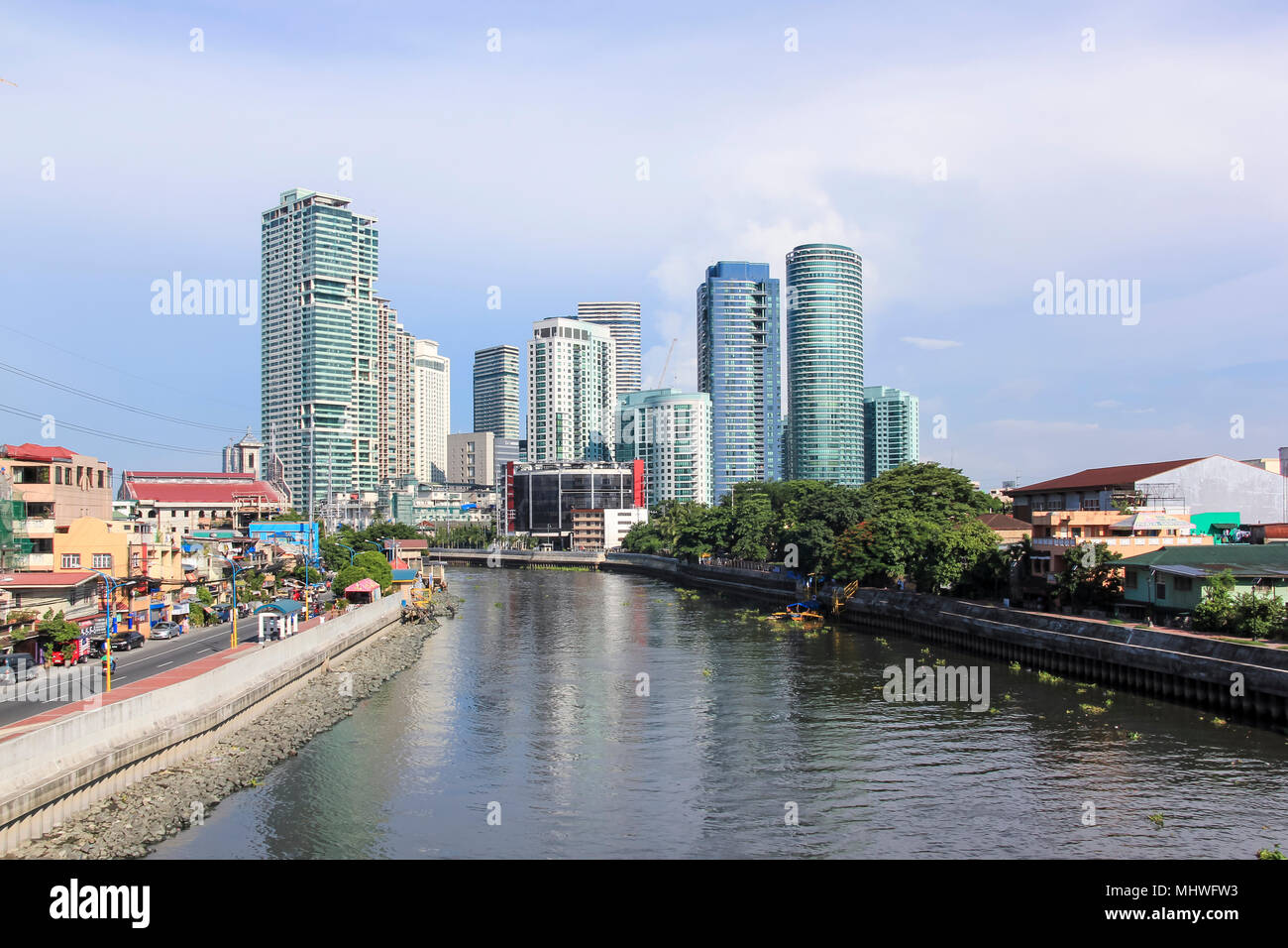 MANILA - JUNE 12: The pasig river in makati passing  by high rise condo buildings of Rockwell distrcit on June 12 2014  in Manila. The 25 kilometre Pa - Stock Image