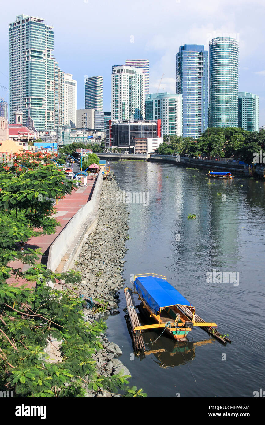 MANILA - JUNE 12: Small passenger ferry boats crossing the pasig river from  makati to highrise Rockwell district on June 12 2014  in Manila. The 25 k - Stock Image