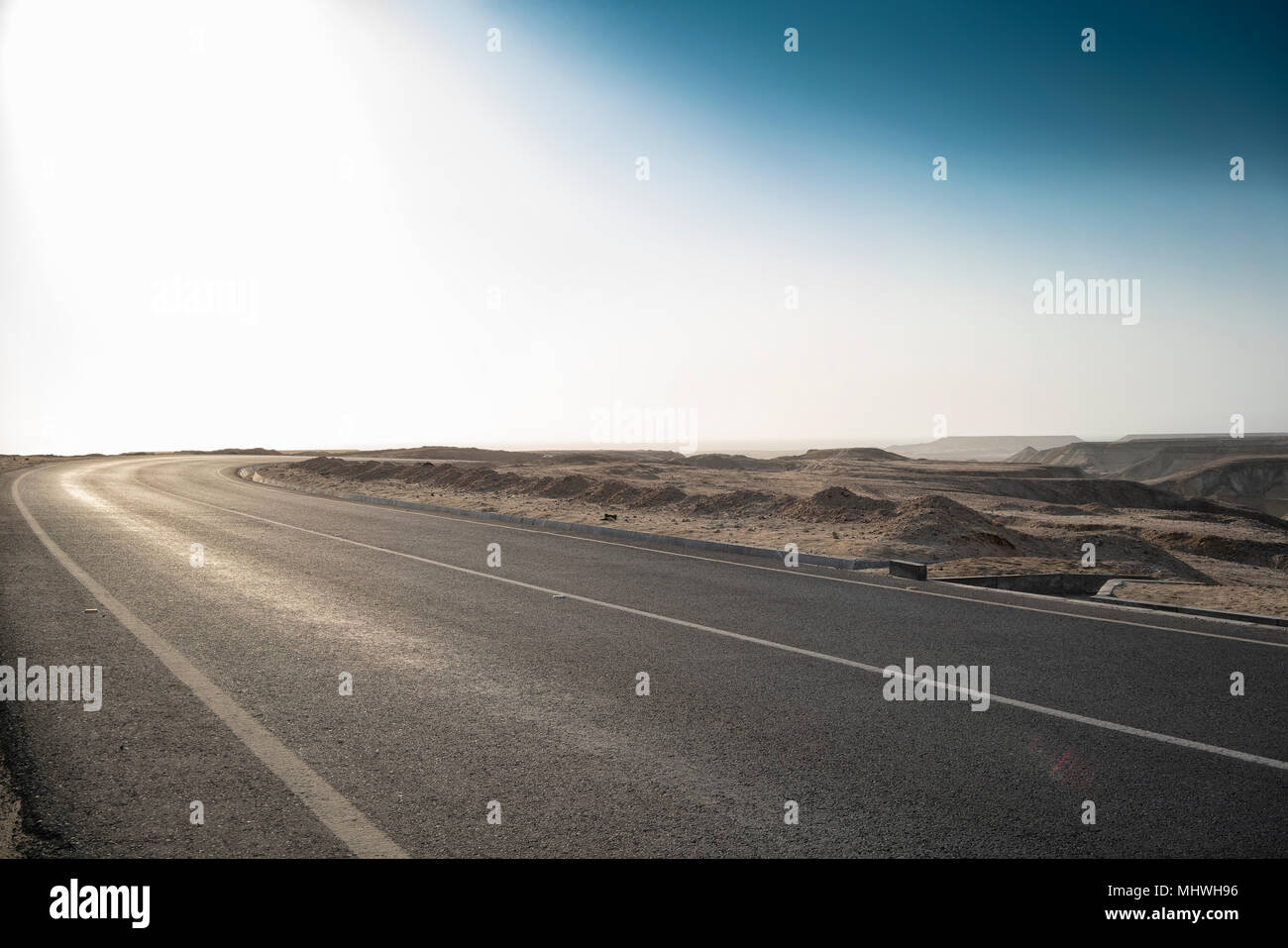Asphalt road of the Namibe Desert. Africa. Angola. - Stock Image