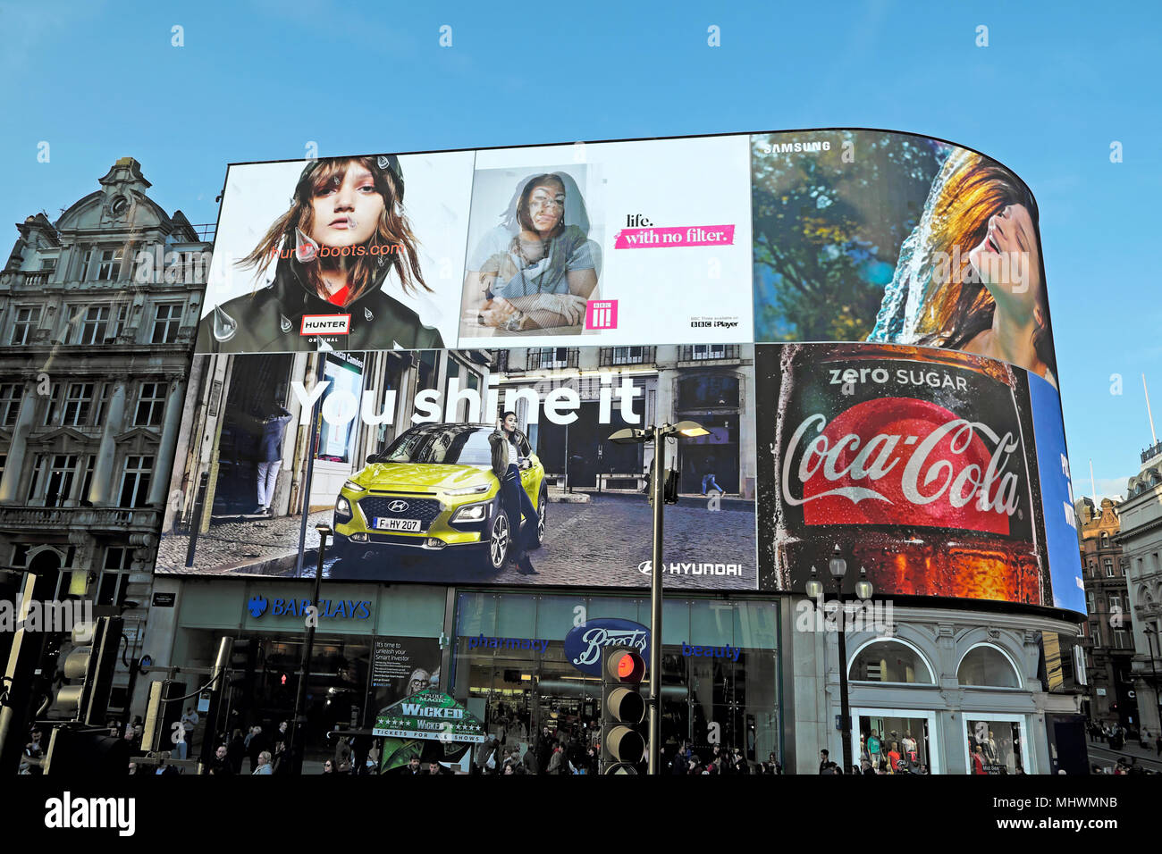 Hunter Boots, Hyundai, Coca Cola, BBC III and Samsung adverts on an electronic advertising billboard Piccadilly Circus, London England UK KATHY DEWITT - Stock Image