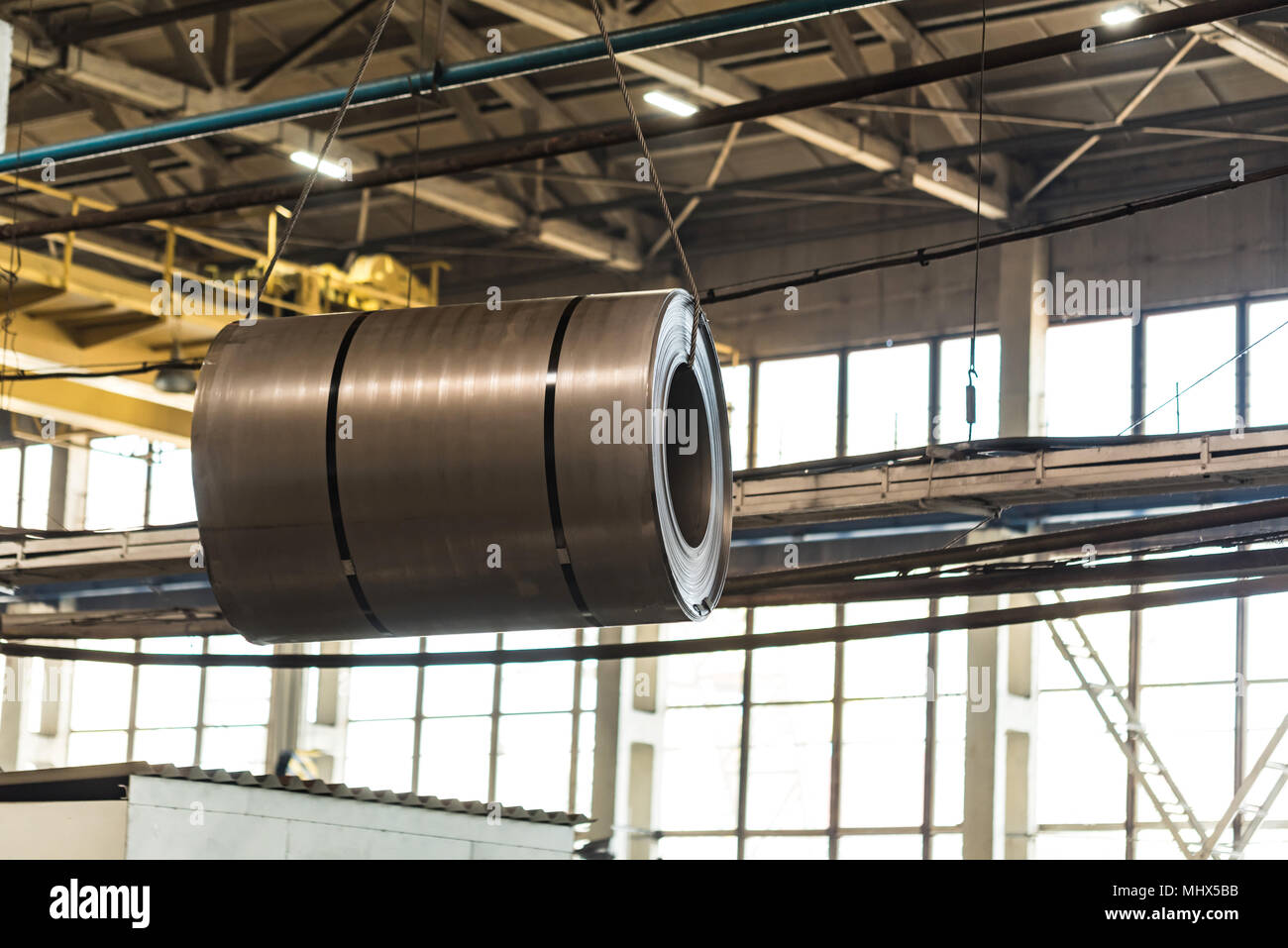 Warehouse with rolls of sheet steel in industrial plant. Hardware manufacturing Stock Photo
