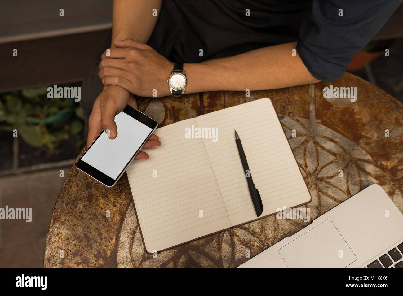 Businessman using mobile phone in cafe - Stock Image
