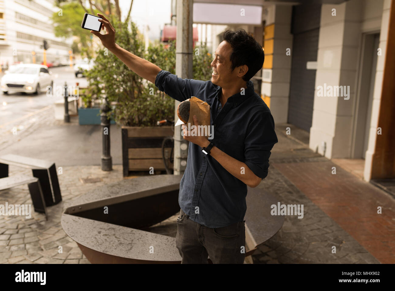 Businessman taking selfie with mobile phone - Stock Image